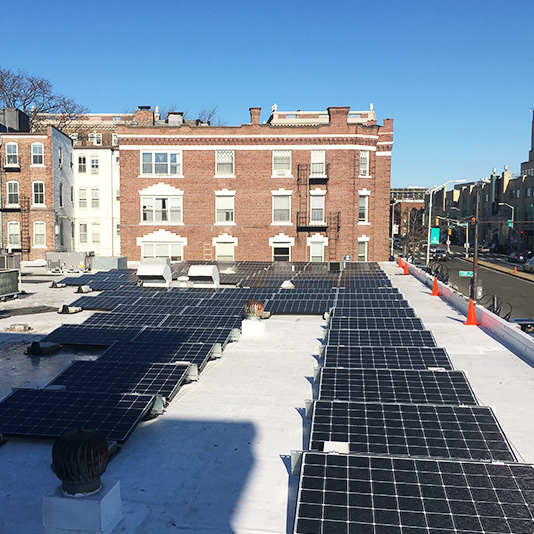 A picture of a roof mount array installed in Cambridge, MA - Mass Renewables Inc.