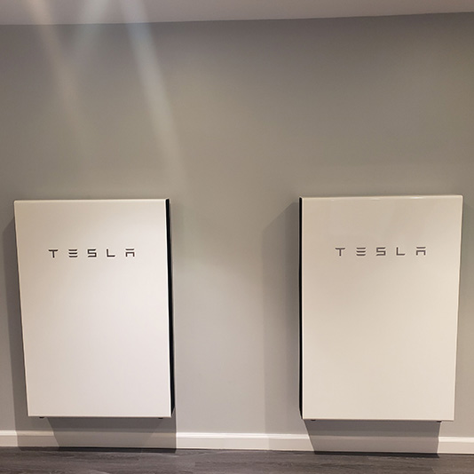 A picture of a Tesla Powerwall installed in Abington, MA - Mass Renewables Inc.